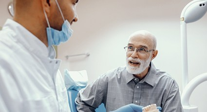 A male patient discussing with the dentist