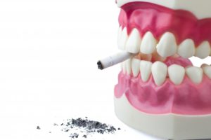 fake teeth with a cigarette